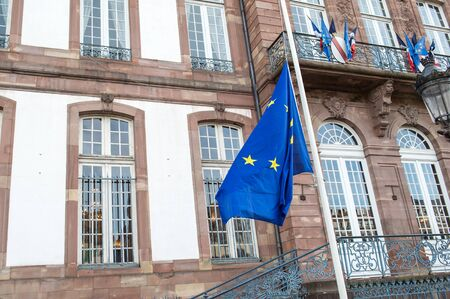 mobilization: STRASBOURG, FRANCE - 14 Nov 2015: The European Union Flag flies at half-mast in front of the Strasbourg City Hall  following an terrorist attack in Paris