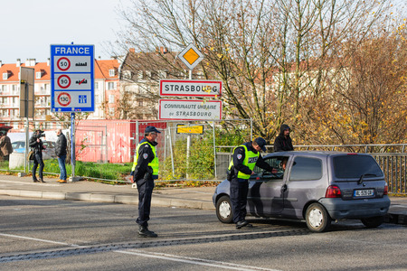 mobilization: STRASBOURG, FRANCE - NOV 14 2015: French Police checking vehicles on the Bridge of Europe between Strasbourg and Kehl Germany, as a security measure in the wake of attacks in Paris - security passport check