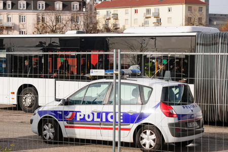 mobilization: STRASBOURG, FRANCE - NOV 14 2015: French Police checking vehicles on the Bridge of Europe between Strasbourg and Kehl Germany, as a security measure in the wake of attacks in Paris - officer body searching bus travelers Editorial