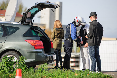 mobilization: STRASBOURG, FRANCE - NOV 14 2015: French Police checking vehicles on the Bridge of Europe between Strasbourg and Kehl Germany, as a security measure in the wake of attacks in Paris - officer body searching drivers, surveillance Editorial