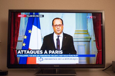 mobilization: PARIS, FRANCE - NOV 13, 2013: Francois Hollande at French Television address to the Nation on the Terrorist Attacks. At least 40 people were killed across Paris, with explosions outside the national stadium where France was hosting German team Editorial