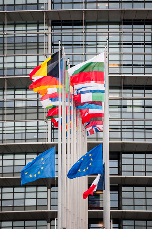 justice for all: STRASBOURG, FRANCE - 14 Nov 2015: European Union Flags and France flag flies at half-mast in front of the European Parliament building following an terrorist attack in Paris