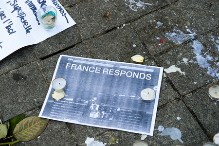 mobilization: STRASBOURG, FRANCE - NOV 16, 2015: France will reply, Messages, candles and flowers are left around General Kleber statue in memorial for the victims of the Paris Attacks.