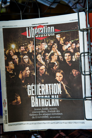 mobilization: STRASBOURG, FRANCE - 16 NOV, 2015: Front covers at press kiosk of International newspapers display headlining the terrorist attacks in Paris on 13 November