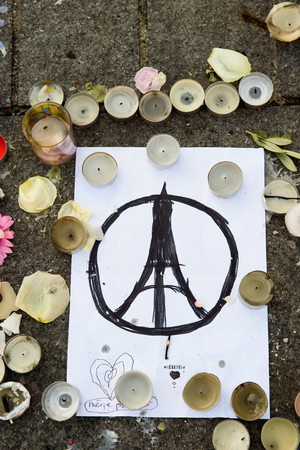 STRASBOURG, FRANCE - NOV 16, 2015: Peace for Paris, messages, candles and flowers are left around General Kleber statue in memorial for the victims of the Paris Attacks.