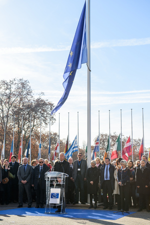 mobilization: STRASBOURG, FRANCE - NOV 16, 2015: Thorbjorn Jagland - Secretary General of the CE and Council of Europe employees during the minute of silence in tribute to the victims of the attacks in Paris which left at least 129 people dead