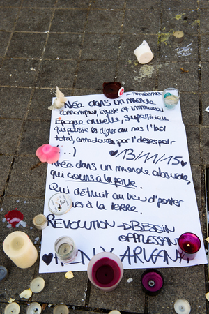 mobilization: STRASBOURG, FRANCE - NOV 16, 2015: Messages, candles and flowers are left around General Kleber statue in memorial for the victims of the Paris Attacks.