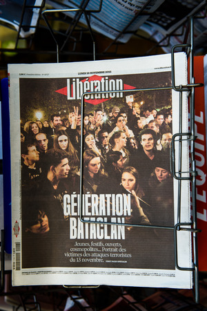 mobilization: STRASBOURG, FRANCE - 16 NOV, 2015: Front covers at press kiosk of International newspapers display headlining the terrorist attacks in Paris on 13 November