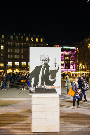 STRASBOURG, FRANCE - NOV 18, 2015: Reporters Without Borders exposing the campaign depicting world-famous dictators giving everyone the finger, or the international equivalent thereof in the cneter of Strasbourg