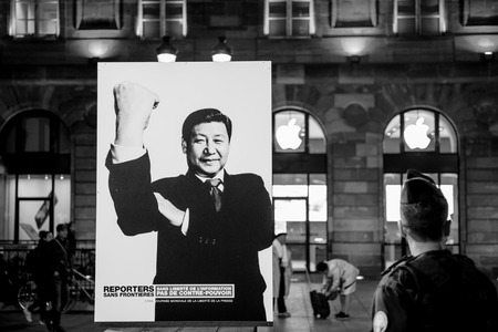 thereof: STRASBOURG, FRANCE - NOV 18, 2015: Reporters Without Borders exposing the campaign depicting world-famous dictators giving everyone the finger, or the international equivalent thereof in the cneter of Strasbourg
