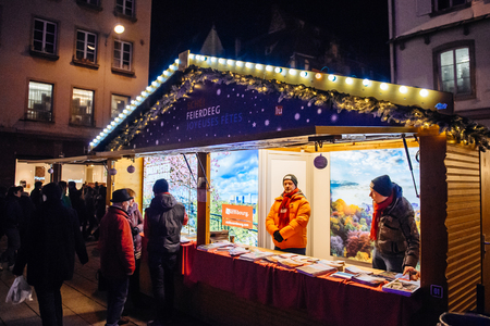 christkindlmarkt: STRASBOURG, FRANCE - NOV 28, 2015: Busy Christmas Market Christkindlmarkt in the city of Strasbourg, Alsace region,  France with kiosk from the City of Luxembourg
