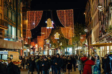 Busy Christmas Market Christkindlmarkt in the city of Strasbourg, Alsace region,  France with