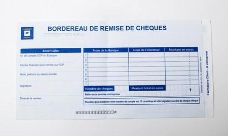 deposit slip: PARIS, FRANCE - JANUARY 14, 2015: Bordereau de remise de cheques on white background issued by the Postal Bank of France - La Banque Postale Editorial