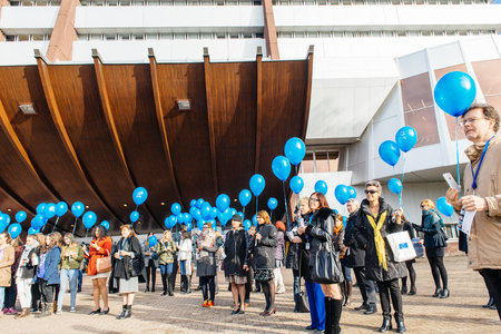 secretariat: STRASBOURG, FRANCE - DEC 09, 2015: COE employees and kids celebrating the first European Day on the Protection of Children against Sexual Exploitation and Sexual Abuse by launching blue balloons Editorial