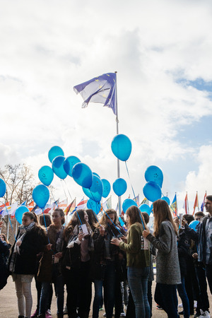 parliamentary: STRASBOURG, FRANCE - DEC 09, 2015: Kids celebrating the first European Day on the Protection of Children against Sexual Exploitation and Sexual Abuse by launching blue balloons in frontof Council of Europe