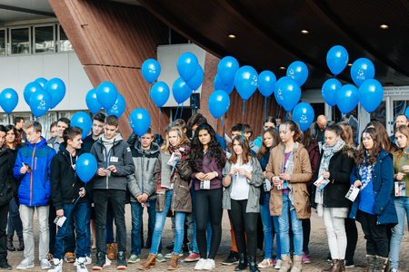 sexual abuse: STRASBOURG, FRANCE - DEC 09, 2015: COE employees and kids celebrating the first European Day on the Protection of Children against Sexual Exploitation and Sexual Abuse by launching blue balloons Editorial
