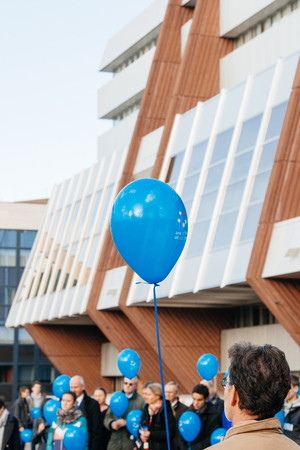 sexual abuse: STRASBOURG, FRANCE - DEC 09, 2015: Man holding balloon during the first European Day on the Protection of Children against Sexual Exploitation and Sexual Abuse Editorial