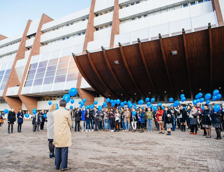 parliamentary: STRASBOURG, FRANCE - DEC 09, 2015: COE employees and kids celebrating the first European Day on the Protection of Children against Sexual Exploitation and Sexual Abuse by launching blue balloons Editorial