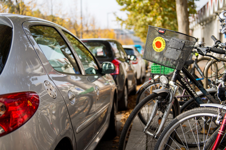 electricity generation: STRASBOURG, FRANCE - NOV 11, 2015: Bike parked near car with stick militating for no Nuclear Power Plants - Nuclear - non merci