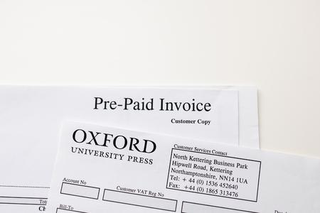 payable: FRANKFURT, GERMANY - JANUARY 14, 2015: Pre-Paird invoice from the Oxford University Press received from the prestigious university