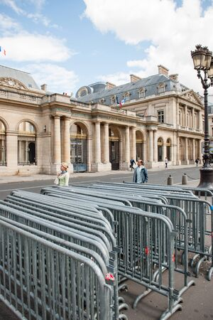 constitutional law: PARIS, FRANCE - AUG 18, 2014: Anti-Protest fences near Conseil dEtat - Council of State building with French flag and Europena Union Flag in Paris France. Council of State is a body of the French national government that acts both as legal adviser of the