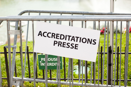 dedicated: Press accreditation dedicated area near a metallic fence Stock Photo