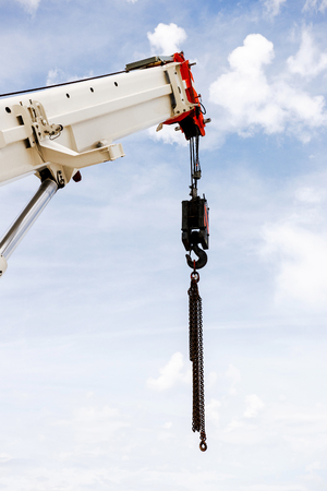 maneuverable: Powerful industrial crane against beautiful and blue sky