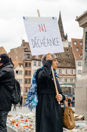 deprivation: PARIS, FRANCE - JAN 30, 2016: Protesters gathered at Kleber Square Place Kleber during a demonstration, protesting governments plan of the extension of the state of emergency for another three months - no deprivation of nationality