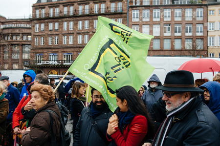 precarious: PARIS, FRANCE - JAN 30, 2016: Protesters gathered at Kleber Square Place Kleber during a demonstration, protesting governments plan of the extension of the state of emergency for another three months Organisation of Equal Womens Editorial