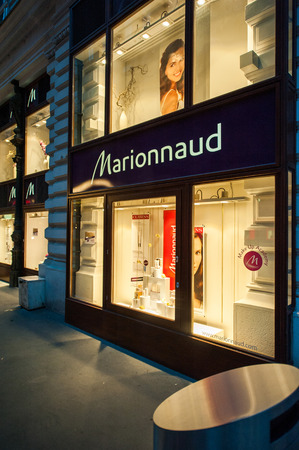 french perfume: VIENNA, AUSTRIA - JUL 4, 2011: Marionnaud beauty and fragrance store at night. Marionnaud is a French brand and chain of cosmetics stores part of Hutchison Whampoa industrial conglomerate Editorial