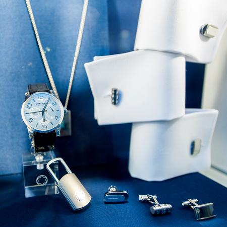 luxury watch: VIENNA, AUSTRIA - JUL 4, 2011: Montblanc luxury businessman accesories as luxury watch, key holder and diverse luxury cuff-links on a blue background Editorial
