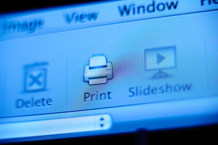 FRANKFURT, GERMANY - SEPT 11, 2011: Print button on Mac OS computer digital display screen. Mac OS is considered one of the most user friendly and ergonomically software operation system