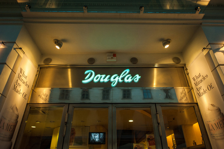ag: VIENNA, AUSTRIA - JULY 4, 2011: Douglas beauty and fragrance store at night. Douglas Holding AG is a German perfume, book, jewelry and confection retailer based in Hagen. Douglas owns more than 1,900 stores, more than 1,500 of which are in Germany, in Eur