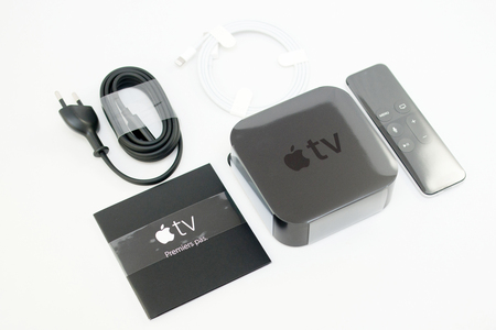 motion sensor: PARIS, FRANCE - NOV 10, 2015: New Apple TV media streaming  player microconsole by Apple Computers - all accessories from above, side.  It has new touch remote swipe-to-select with integrated Siri and motion sensor