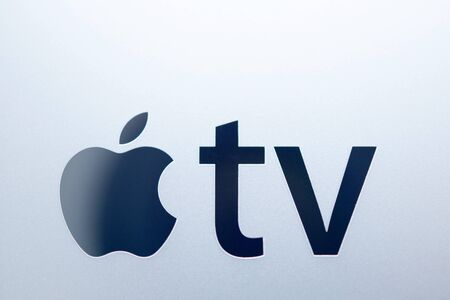 motion sensor: PARIS, FRANCE - NOV 10, 2015: Apple logo on the new Apple TV media streaming  player microconsole by Apple Computers featuring a new touch remote swipe-to-select with integrated Siri and motion sensor Editorial