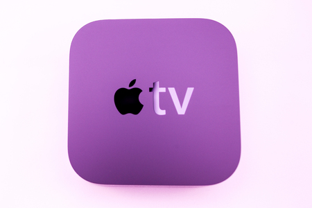 motion sensor: PARIS, FRANCE - NOV 10, 2015: New Apple TV media streaming  player microconsole by Apple Computers - isolated on white. It has new touch remote swipe-to-select with integrated Siri and motion sensor