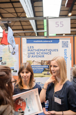 career path: STRASBOURG, FRANCE - FEB 4, 2016: Children and teens of all ages attending annual Education Fair to choose career path and receive vocational counseling - Superior Mathematics faculty stand Editorial