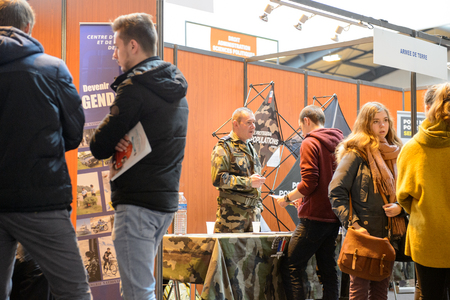 career path: STRASBOURG, FRANCE - FEB 4, 2016: Children and teens of all ages attending annual Education Fair to choose career path and receive vocational counseling - French Army stand
