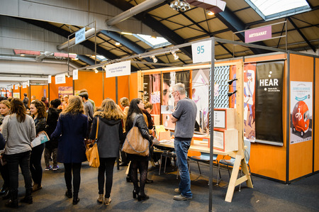 career path: STRASBOURG, FRANCE - FEB 4, 2016: Children and teens of all ages attending annual Education Fair to choose career path and receive vocational counseling - HEAR SChool Editorial