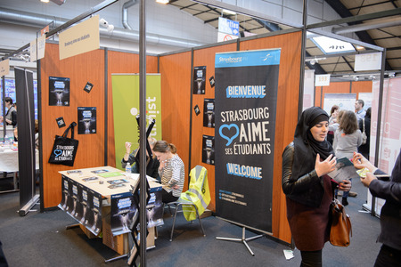 career path: STRASBOURG, FRANCE - FEB 4, 2016: Children and teens of all ages attending annual Education Fair to choose career path and receive vocational counseling - Strasbourg City stand