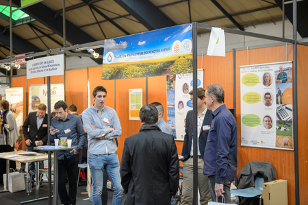 career path: STRASBOURG, FRANCE - FEB 4, 2016: Children and teens of all ages attending annual Education Fair to choose career path and receive vocational counseling - Ecology faculty stand