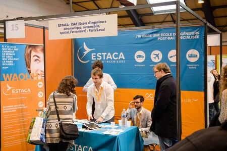 career path: STRASBOURG, FRANCE - FEB 4, 2016: Children and teens of all ages attending annual Education Fair to choose career path and receive vocational counseling - ESTACA school Paris Laval