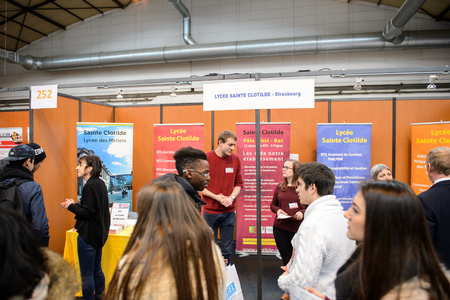career path: STRASBOURG, FRANCE - FEB 4, 2016: Children and teens of all ages attending annual Education Fair to choose career path and receive vocational counseling - Lycee Sainte Clotilde Editorial