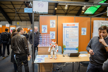 career path: STRASBOURG, FRANCE - FEB 4, 2016: Children and teens of all ages attending annual Education Fair to choose career path and receive vocational counseling - Robotics and Engineering stand