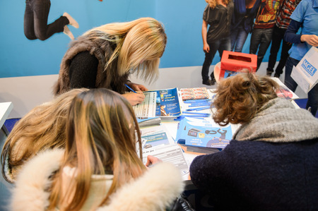 career path: STRASBOURG, FRANCE - FEB 4, 2016: Children and teens of all ages attending annual Education Fair to choose career path and receive vocational counseling - Baccalaureat platform