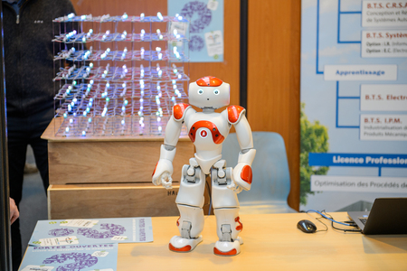 career fair: STRASBOURG, FRANCE - FEB 4, 2016: Children and teens of all ages attending annual Education Fair to choose career path and receive vocational counseling - Robot at engineering studies stand Editorial