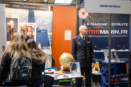 vocational: STRASBOURG, FRANCE - FEB 4, 2016: Children and teens of all ages attending annual Education Fair to choose career path and receive vocational counseling - French Marine recuriting Editorial