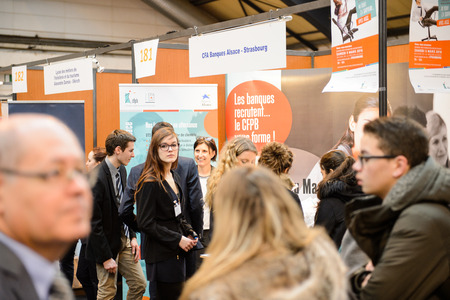vocational: STRASBOURG, FRANCE - FEB 4, 2016: Children and teens of all ages attending annual Education Fair to choose career path and receive vocational counseling - Banking studies Editorial