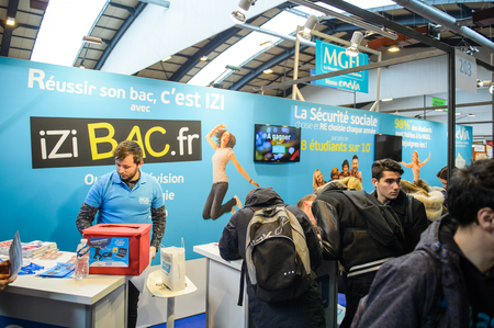 career path: STRASBOURG, FRANCE - FEB 4, 2016: Children and teens of all ages attending annual Education Fair to choose career path and receive vocational counseling - Bacalaureat online platform Editorial