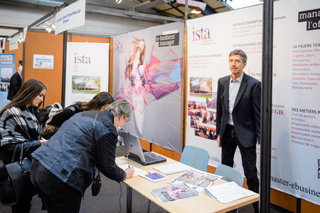 career path: STRASBOURG, FRANCE - FEB 4, 2016: Children and teens of all ages attending annual Education Fair to choose career path and receive vocational counseling - ISTA textile school stand